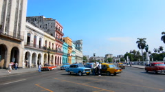 Stock Video Footage of Havana Cuba old classic cars and taxis on street at Capital in downtown city of