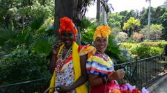 Cuba Havana Habana women with flowers and cigar in costume in Old Havana   3 Stock Footage