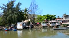 Havana Cuba old homes and boats in Jaimanitas River in Jaimanitas Habana Stock Footage