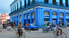 Stock Video Footage of Cardenas Cuba downtown color and traffic in beautiful small town cars peditaxis