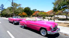 Havana Cuba pink classic 1950s auto in beautiful neighborhood of Habana parked Stock Footage