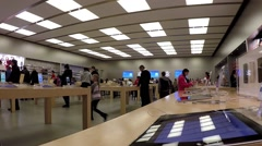 People buying new iphone inside apple store Stock Footage