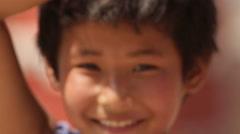 Kathmandu Nepal two children pose at school in Eastern Kathmandu, Nepal Stock Footage