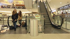 crowd of people quickly moves to the next floor to the revelation of escalators - stock footage