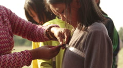 Kathmandu Nepal child getting measured for costumes at childrens home, Eastern Stock Footage