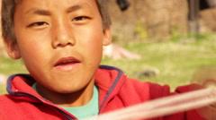 Kathmandu Nepal Nepali boy spinning toy wheel in Nayapati, Eastern Kathmandu  1 Stock Footage