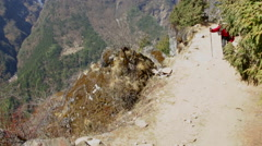 Himalayas Nepal porter carrying load up steps in SoluKhumbu, Nepal - stock footage