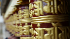 Nepal Himalayas  Buddhist spinning prayer wheels in the village of Khumjung Stock Footage
