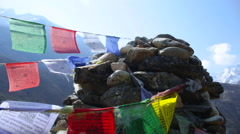 Himalayas Nepal Memorial rock pile with prayer flags in SoluKhumbu, Nepal - stock footage
