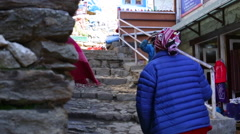 Himalayas Nepal Village child and villagers on steps in Namche Bazarre  in Stock Footage