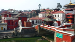 Kathmandu Nepal Pashupatinath Temple and bridge with public cremations and cows Stock Footage
