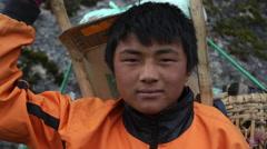Himalayas Nepal Porter in Solukhumbu posing for camera with basket in Himalayas Stock Footage