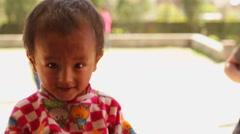 Kathmandu Nepal young child outside school in Eastern Kathmandu, Nepal Stock Footage