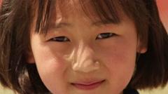 Kathmandu Nepal Nepali child age 9 posing for camera Nayapati, Eastern Kathmandu Stock Footage