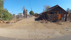 Driving By Dilapidated Wooden Shack In Small Desert Town- Niland CA Stock Footage
