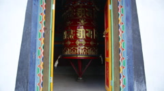 Nepal Himalayas prayer wheel spinning in Buhhdist shrine in the village of Stock Footage