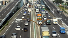 Busy Truck Traffic on Japanese Highway - Tokyo Japan - stock footage