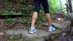 Young woman hiking the Benton Falls Trail in Ocoee, Tennessee USA Stock Footage