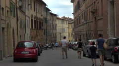 Siena Italy winding narrow road alley apartments people 4K 003 Stock Footage