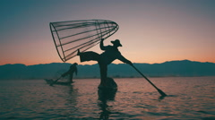 Two Traditional Burmese Fisherman on Inle Lake at Dawn Stock Footage