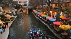 San Antonio Texas famous The Riverwalk at night with boats and restaurants with Stock Footage