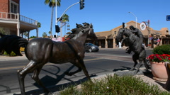 Old Scottsdale Arizona cowboy statue in tourist area 5th Avenue and  Scottsdale Stock Footage