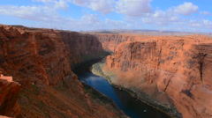 Page Arizona Glen Canyon Dam on Colorado River scenics with rocks and clouds for Stock Footage