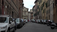 Siena Italy winding narrow road alley apartments traffic 4K 002 Stock Footage