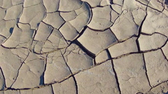 Zoom On Cracks In Mud Of Dried Lake Bed Stock Footage