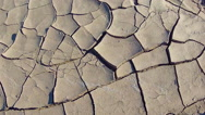 Stock Video Footage of Zoom On Cracks In Mud Of Dried Lake Bed