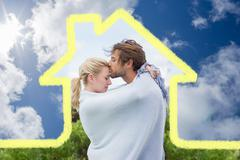 Composite image of cute affectionate couple standing outside wrapped in blanket Stock Illustration