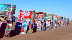 Amarillo Texas famous Cadillac Ranch off of Route 66 graphic look at old Stock Footage