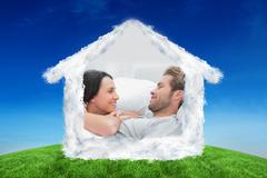 Composite image of cheerful couple awaking and looking at each other Stock Photos
