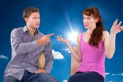 Stock Photo of Composite image of sitting couple having an argument