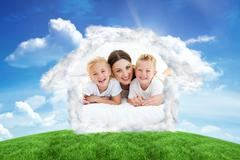 Composite image of laughing children playing with their mother lying on a bed Kuvituskuvat