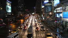 Bangkok pedestrians and traffic at night Stock Footage