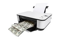 Printer printing fake dollar bills Stock Photos