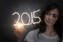 Composite image of businesswoman touching spark - stock photo