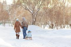 Young parents walking in winter Stock Photos