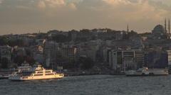 Istanbul Turkey Mosque ferry boat Bosporus Strait pan 4K 090 Stock Footage
