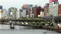 Time Lapse of Passenger Train Passing Tokyo Skyline Daytime - Tokyo Japan Arkistovideo