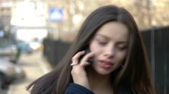 Girl with mobile phone frowning her eyebrows Stock Footage