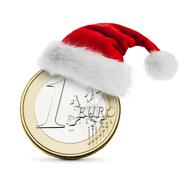 Santa hat on coin one euro - stock photo