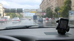 Cars move on wet street at summer in Moscow. Stock Footage
