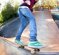 Skateboarder legs before jumping in the halfpipe. shooting fisheye lens optic Stock Photos