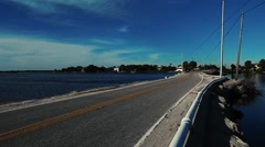 Low bridge going out to island Stock Footage