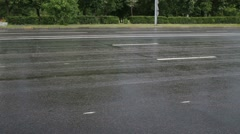 Lot of cars go fast on wet road in rain at summer day Stock Footage