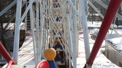 Moving parts of large white ferris wheel in winter day Stock Footage