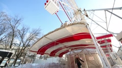 Woman comes from Ferris wheel and speaks near ferris wheel Stock Footage