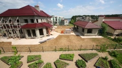 Above view to small garden and cottages under construction Stock Footage